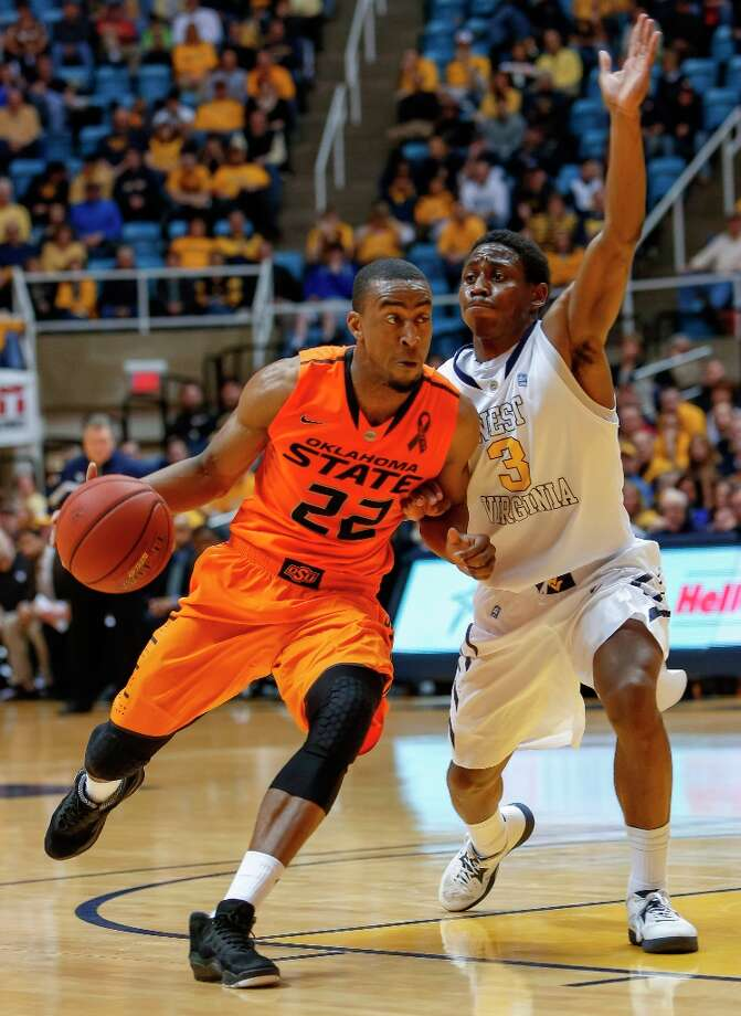 Who's hot:  Oklahoma State G Markel Brown, who has scored in double figures in nine straight games and 23 of 26 games this season. Brown is averaging 18.8 points per game during his last nine games. Photo: DAVID SMITH, Associated Press / FR93543 AP