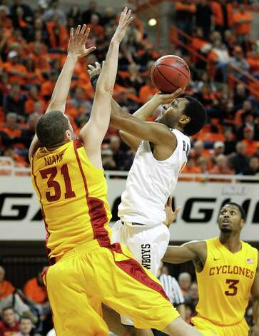 Who's hot:  Oklahoma State G Brian Williams, who tallied 13 points in 22 minutes in the Cowboys' victory at West Virginia. Williams, who has struggled with an injured left wrist most of the season, had scored 15 points combined earlier in the season. Photo: Sue Ogrocki, Associated Press / AP