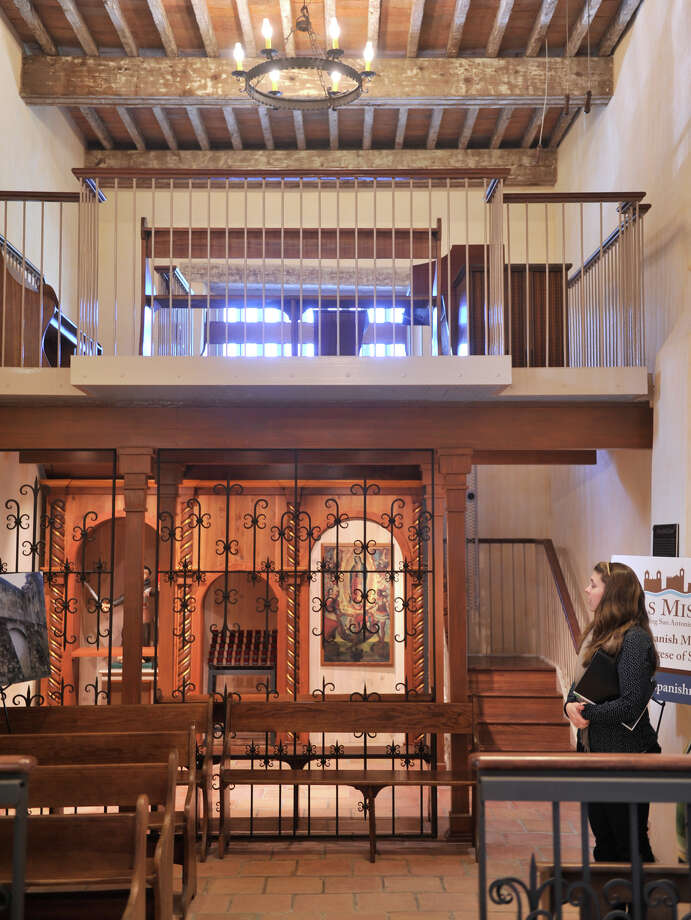 Anna Nau of the architectual firm Ford, Powell, and Carson, looks over the new devotional area under the choir loft following a $2.2 million renovation to Mission San Juan Capistrano. Photo: Robin Jerstad