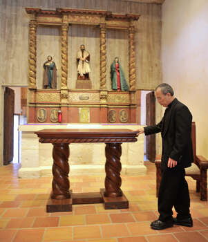 Fr. David Garcia, Archdiocesan Director of the Old Spanish Missions, looks over the new altar in Mission San Juan Capistrano during a media tour Monday following the completion of a $2.2 million restoration. The altar was originally used in San Fernando Cathedral. Photo: Robin Jerstad