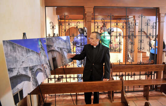 Fr. David Garcia, Archdiocesan Director of the Old Spanish Missions stands in front of a new devotional area as he shows off images from before a recently completed $2.2 million restoration to the church. Photo: Robin Jerstad
