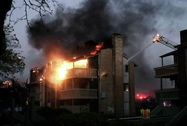 A three-alarm fire also destroyed part of a major apartment complex on the North Side, in the 10,800 block of Sahara near U.S. 281. Photo: Darren Abate, Darren Abate/For The Express-New
