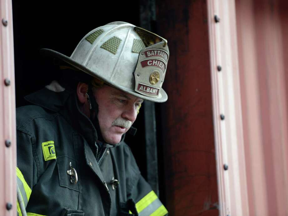 Albany Fire Department Battalion Chief Mike Burns watches as probationary firefighters go through their evolutions at the training tower Feb. 25, 2013 in Latham, N.Y.  The training exercise was designed to remove a downed firefighter from a building as quickly as possible. (Skip Dickstein/Times Union) Photo: SKIP DICKSTEIN