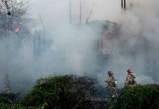 Firefighters work to contain a structure fire, Monday, Feb. 25, 2013, at an apartment complex in the 10300 block of Sahara St. in San Antonio. Photo: Darren Abate, Darren Abate/For The Express-New