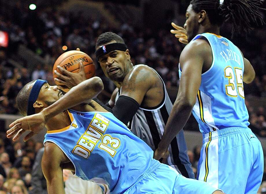 Stephen Jackson of the Spurs looks to shoot as Corey Brewer (13) and Kenneth Faried (35) of the Denver Nuggets defend in the AT&T Center on Nov. 17, 2012. Photo: Billy Calzada, San Antonio Express-News / SAN ANTONIO EXPRESS-NEWS