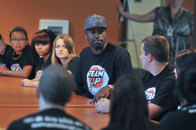 Stephen Jackson of the Spurs talks to the Student Council and the Student Leadership council of East Central High School Wednesday afternoon. Jackson was there to help students stuff backpack with lunches as part of the Team Up Challenge. Photo: Robin Jerstad/For The Express-Ne