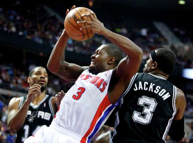 Detroit Pistons guard Rodney Stuckey (3) grabs a rebound in front of Spurs guard Gary Neal, left, and forward Stephen Jackson (3) in the second half Friday, Feb. 8, 2013, in Auburn Hills, Mich. The Pistons defeated the Spurs 119-109. Photo: Duane Burleson, Associated Press / FR38952 AP