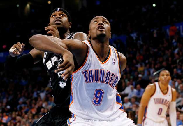 Oklahoma City Thunder forward Serge Ibaka (9) and Spurs forward Stephen Jackson (3) fight for position during a foul shot in the fourth quarter in Oklahoma City, Monday, Dec. 17, 2012. Oklahoma City won 107-93. Photo: Sue Ogrocki, Associated Press / AP