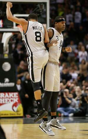 The Spurs' Patty Mills celebrates with Stephen Jackson after Jackson scored a 3-pointer against the Minnesota Timberwolves in the second half at the AT&T Center, Sunday, Jan. 13, 2013. The Spurs won 106-88. Photo: Jerry Lara, San Antonio Express-News / © 2013 San Antonio Express-News