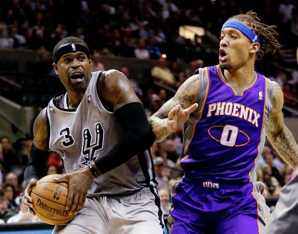 The Spurs' Stephen Jackson (3) drives past Phoenix Suns' Michael Beasley (0) during the first quarter Saturday, Jan. 26, 2013, in San Antonio. Photo: Eric Gay, Associated Press / AP