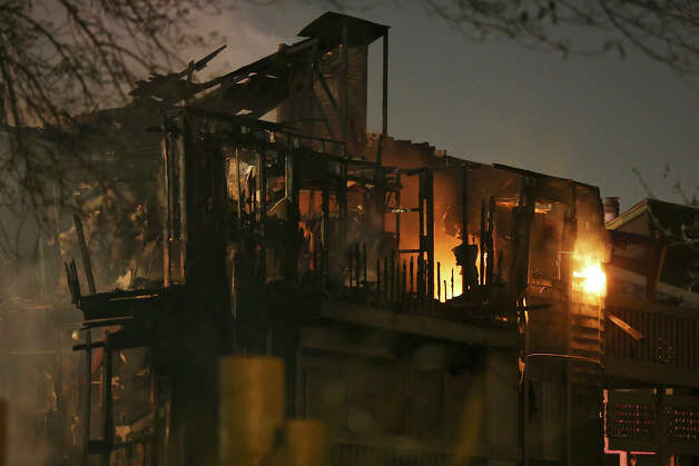The remains of apartments after a fire at the Wood Hollow Apartment Homes in the 10,300 block of Sahara Drive Monday Feb. 25, 2013. Photo: Edward A. Ornelas, San Antonio Express-News / © 2013 San Antonio Express-News