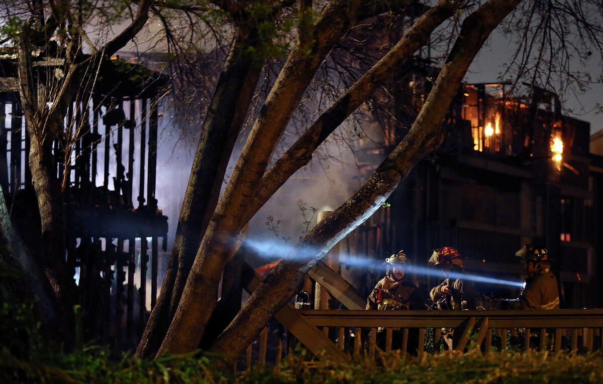 Firefighters work the scene of a fire at the Wood Hollow Apartment Homes in the 10,300 block of Sahara Drive Monday Feb. 25, 2013.