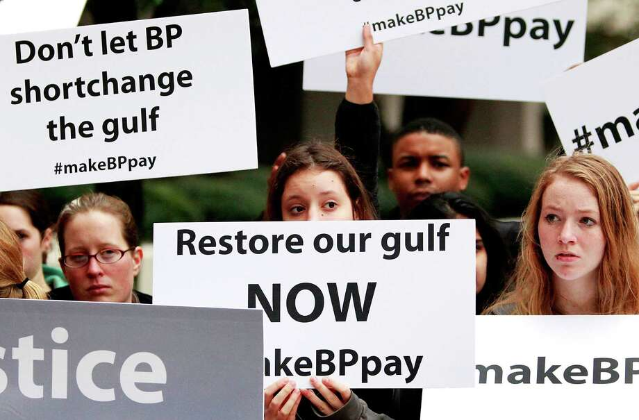 NEW ORLEANS, LA - FEBRUARY 25:  Activists holds signs during a protest in front of the Hale Boggs Federal Building on the first day of the trial over the Deep Water Horizon oil rig spill on February 25, 2013 in New Orleans, Louisiana. 11 men were killed during the accident and over 4 million barrels of oil spilled into the Gulf of Mexico in 2010. (Photo by Sean Gardner/Getty Images) *** BESTPIX *** Photo: Sean Gardner, Stringer / 2013 Getty Images