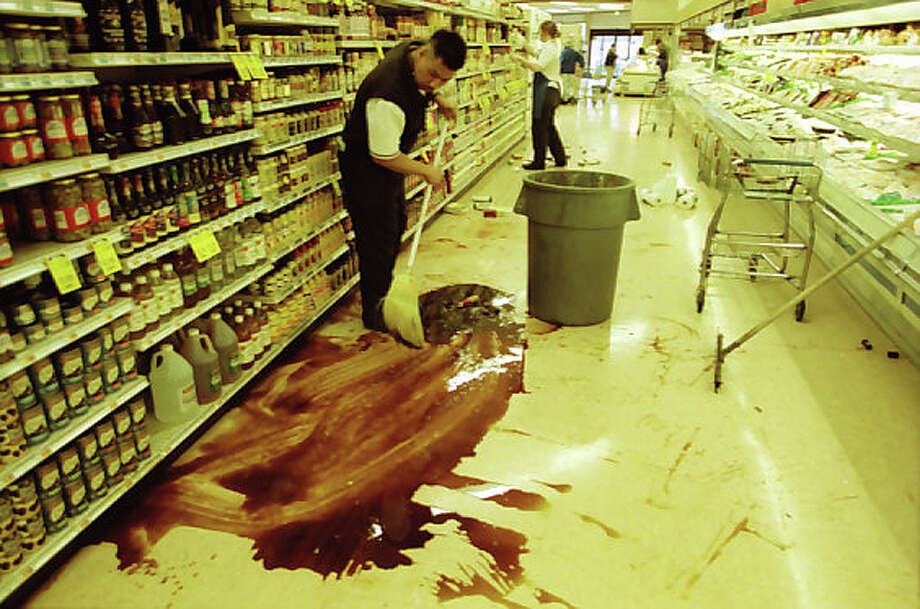 Workers at this Seattle QFC had to clean up jars that spilled after the Nisqually earthquake on Feb. 28, 2001. This image was not previously published. Photo: Meryl Schenker/MOHAI Seattle Post-Intelligencer Collection/seattlepi.com File