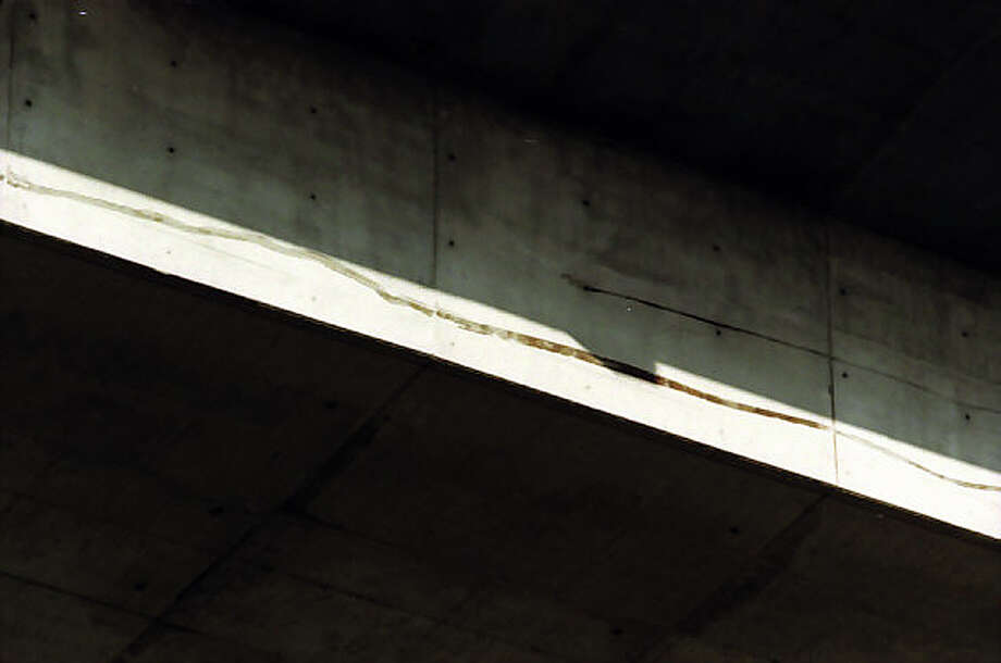 P-I photographer Phil H. Webber captured this image of cracks in the Alaskan Way Viaduct the day of the Feb. 28, 2001 Nisqually earthquake. The image has not previously been published. Photo: Phil H. Webber/MOHAI Seattle Post-Intelligencer Collection/seattlepi.com File