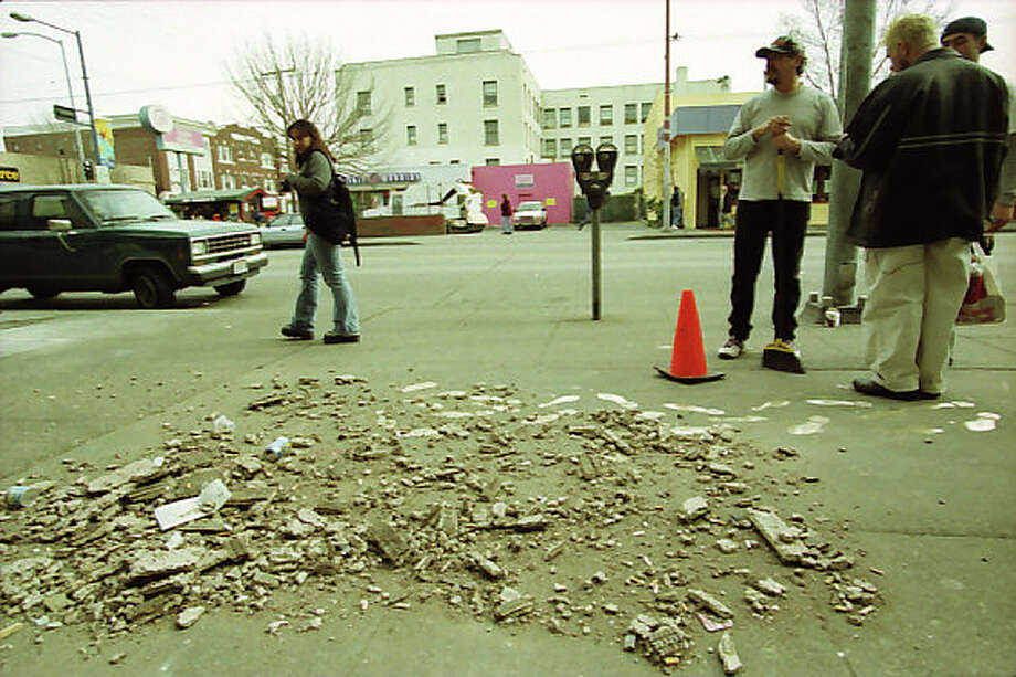 A previously unpublished frame from Feb. 28, 2001, showing damage in the Capitol Hill neighborhood after the Nisqually earthquake. Information preserved with the negatives does not give additional information about the picture, taken after the 6.8 magnitude quake. Photo: Meryl Schenker/MOHAI Seattle Post-Intelligencer Collection/seattlepi.com File