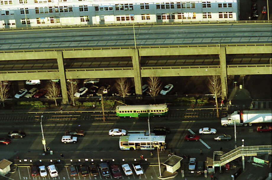 In 2001, the George Benson Waterfront Streetcar Line still ran along the waterfront. This image, taken the day of the Nisqually earthquake, has not previously been published. Photo: Meryl Schenker/MOHAI Seattle Post-Intelligencer Collection/seattlepi.com File