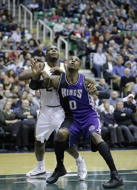 Utah Jazz's Paul Millsap, left, and Sacramento Kings' Thomas Robinson (0) battle for position under the boards in the second half during an NBA basketball game Monday, Feb. 4, 2013, in Salt Lake City. (AP Photo/Rick Bowmer) Photo: Rick Bowmer, STF / AP2013