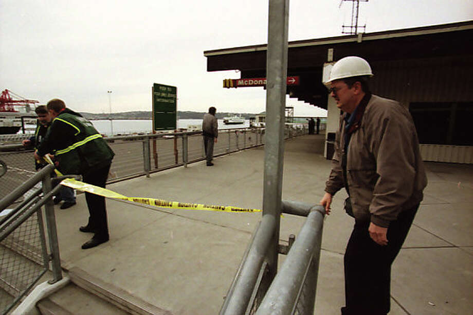 Here are some of previously unpublished P-I photos of workers closing parts of Colman Dock after the Feb. 28, 2001 Nisqually earthquake. The 6.8 magnitude quake was centered about 11 miles from Olympia. Photo: Phil H. Webber/MOHAI Seattle Post-Intelligencer Collection/seattlepi.com File