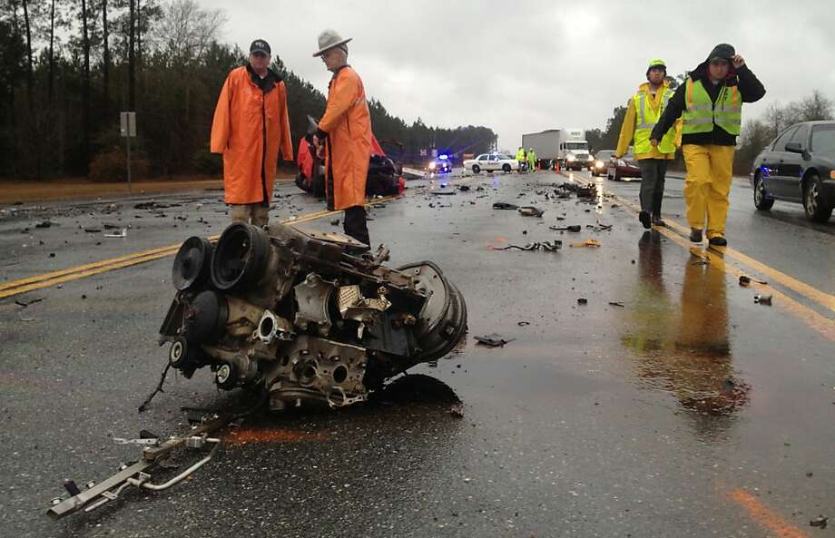 The engine block from a pick up truck lays in the center of Ga 27/341 after striking a Wayne County school bus Monday, Feb. 25, 2013, near Jesup, Ga.  The collision between a school bus and a truck in Wayne County has left the truck driver dead and several students with minor injuries. Photo: Lewis Levine, Associated Press