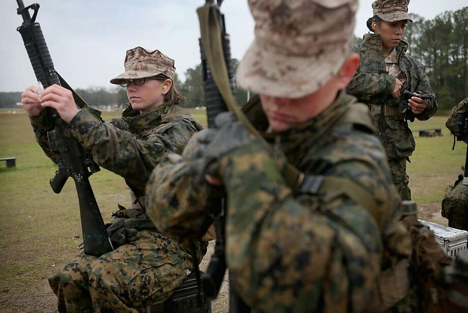Female Marine recruits prepare to fire on the rifle range during boot camp February 25, 2013 at MCRD Parris Island, South Carolina. All female enlisted Marines and male Marines who were living east of the Mississippi River when they were recruited attend boot camp at Parris Island. About six percent of enlisted Marines are female. Photo: Scott Olson, Getty Images