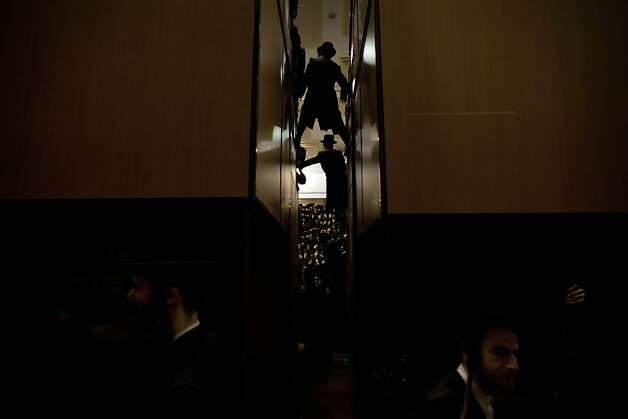 Ultra-Orthodox Jewish men gather at a yeshiva, a rabbinical seminary, during Purim celebrations in Jerusalem,  Monday, Feb. 25, 2013. The Jewish holiday of Purim commemorates the Jews' salvation from genocide in ancient Persia, as recounted in the Book of Esther which is read in synagogues. Photo: Sebastian Scheiner, Associated Press