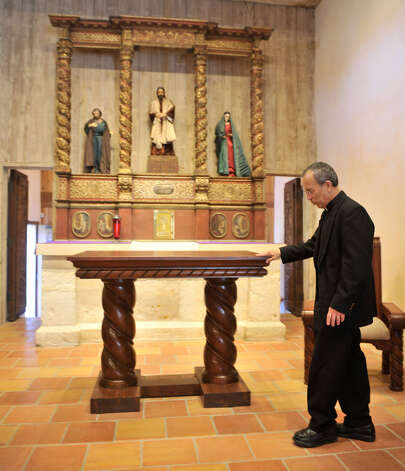 ABOVE: Father David Garcia, director of the Old Spanish Missions, looks over the new altar in Mission San Juan Capistrano after the completion of a $2.2 million restoration. The altar originally was used in San Fernando Cathedral. Photo: Photos By Robin Jerstad / For The San Antonio Express-News