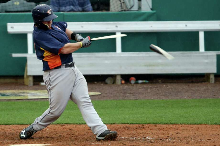 The Astros' Chris Wallace makes short work of his bat while hitting a pitch off St. Louis' Keith Butler in the ninth inning of Monday's exhibition at Jupiter, Fla. Photo: Julio Cortez, STF / AP