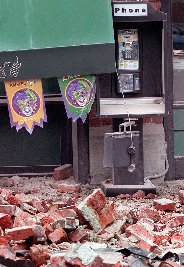 This was one of the published P-I photos taken after the 2001 Nisqually Earthquake, and the original caption read: A phone hangs off the hook near the Fenix Underground after the awning collapsed when bricks fell from an above story. Photo: Renee C. Byer/seattlepi.com File, SEATTLE POST INTELLIGENCER  / -