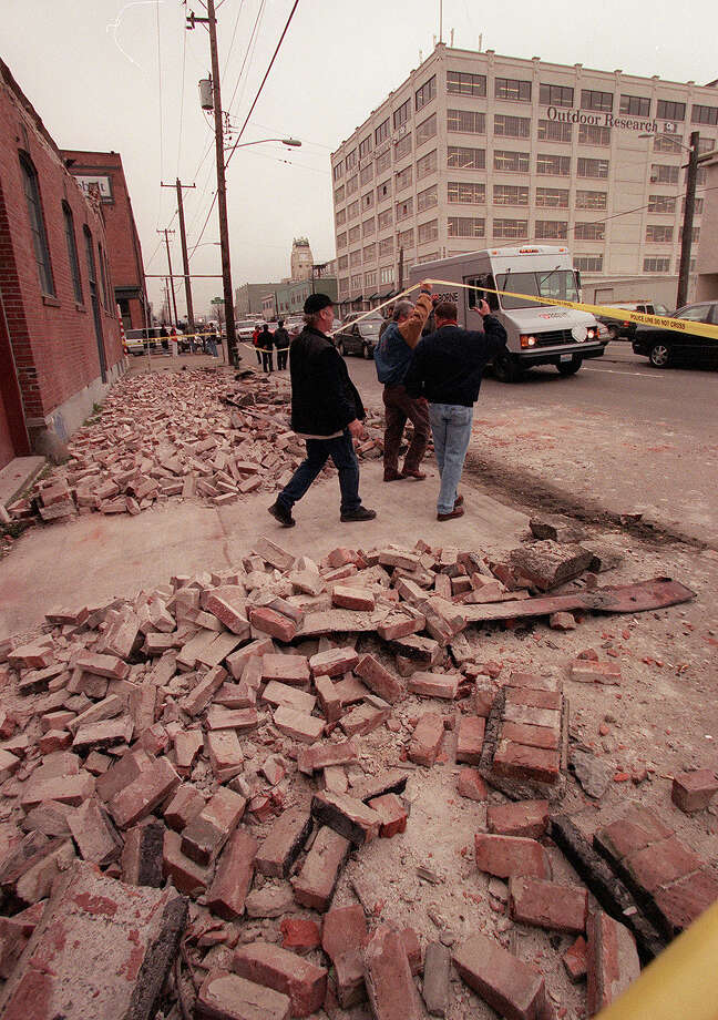 This was one of the published P-I photos taken after the 2001 Nisqually Earthquake, and the original caption read: Empolyes of Seattle Chocolates leave thier building on First Avenue South. The building was heavely damaged during yesterday's earthquake. Photo: Phil H. Webber/seattlepi.com File / -