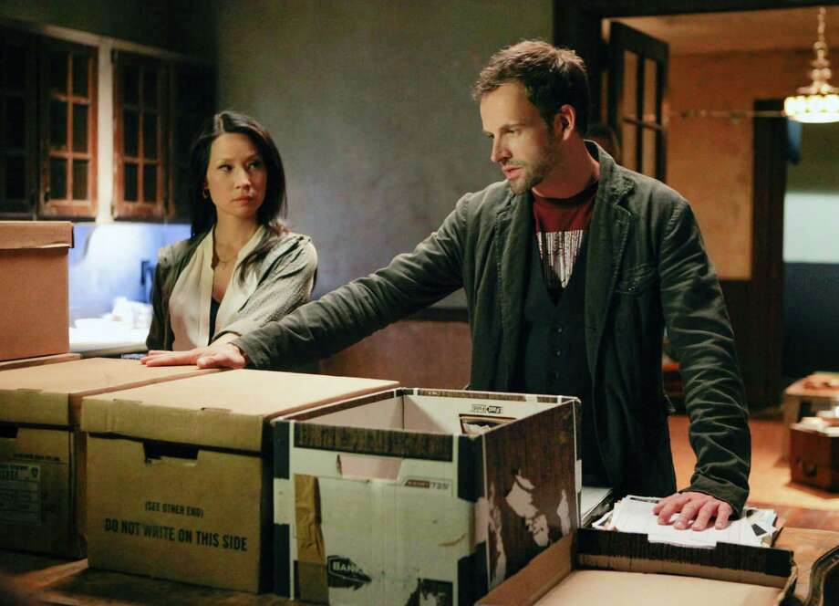 "This publicity image released by CBS shows Jonny Lee Miller, right, and Lucy Liu in a scene from the series, ""Elementary.""  (AP Photo/CBS, Giovanni Rufino) Photo: Giovanni Rufino"