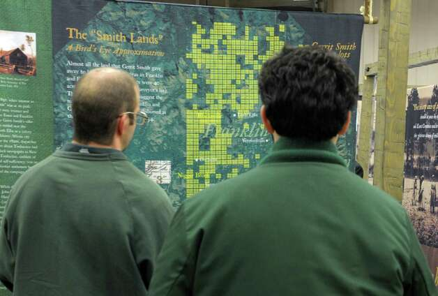 "Inmates  at the Adirondack Correctional Facility look over the exhibit  ""Dreams of Timbuctoo"" on Monday, Feb. 25, 2013 in Ray Brook, NY.  The exhibit deals with the giving of land to African American males and the history of  voting rights in the Adirondacks.  (Paul Buckowski / Times Union) Photo: Paul Buckowski  / 00021238A"