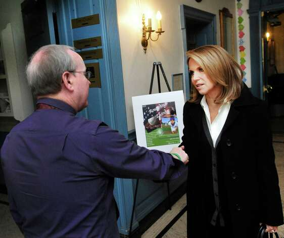 Katie Couric thanks Tom Mahoney, theater manager, as she leaves Edmond Town Hall in Newtown, Conn. after taping a show about the Sandy Hook shootings, Monday, Feb. 25, 2013. Photo: Michael Duffy / The News-Times