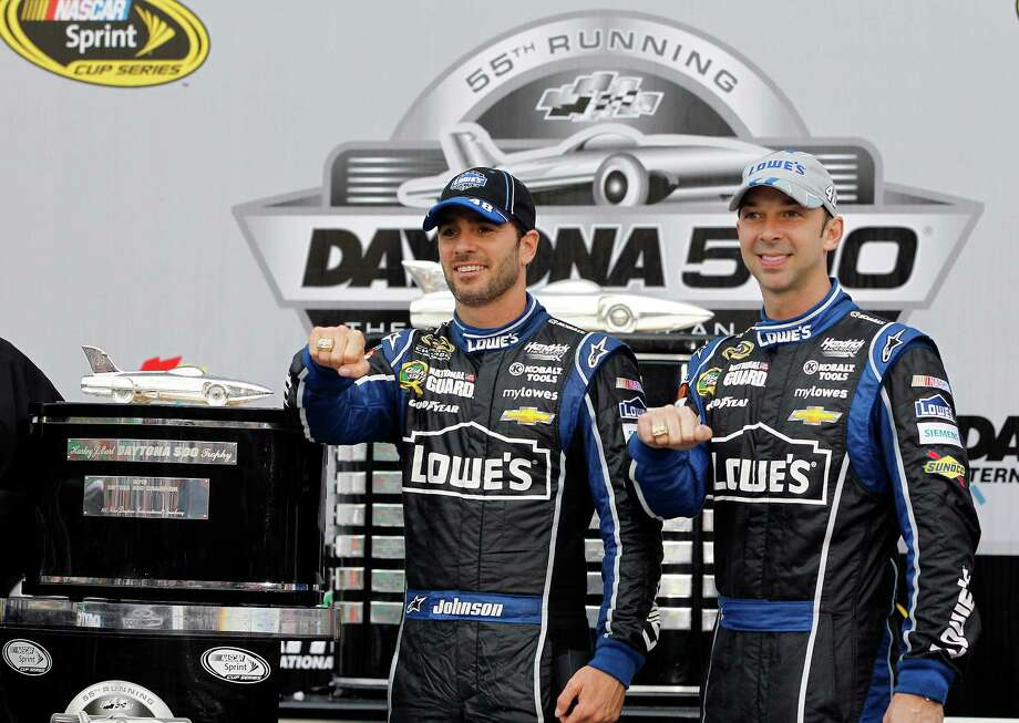 FILE - In this Feb. 24, 2013 file photo, Jimmie Johnson, left,  and crew chief Chad Knaus wear Daytona 500 rings after winning the Daytona 500 NASCAR Sprint Cup Series auto race at Daytona International Speedway in Daytona Beach, Fla. It was important to Johnson to win a Daytona 500 with crew chief Chad Knaus there. (AP Photo/Terry Renna, File) Photo: Terry Renna