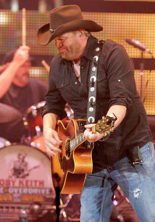 Toby Keith performs during the Houston Livestock Show and Rodeo at Reliant Stadium Monday, Feb. 25, 2013, in Houston. Photo: Melissa Phillip, Houston Chronicle / © 2013  Houston Chronicle
