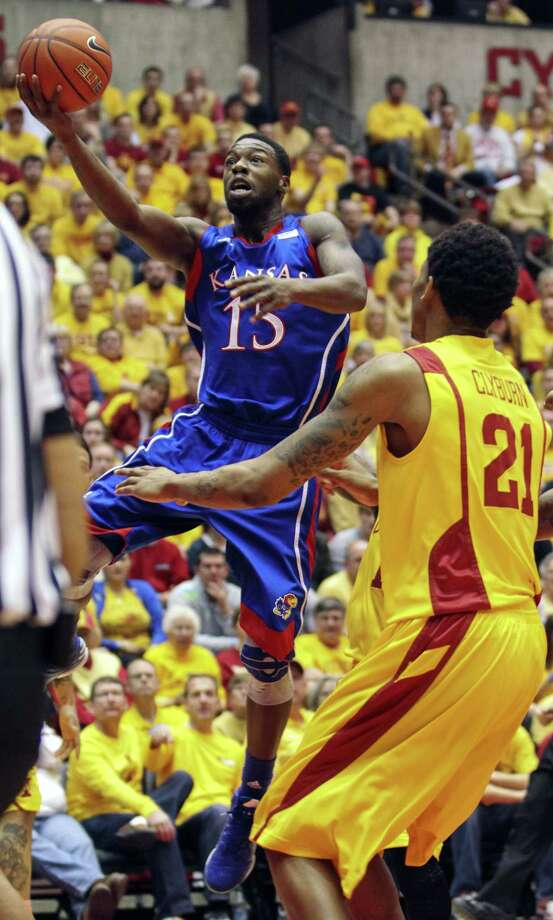 Kansas' Elijah Johnson drives for two of his career-high 39 points in Monday's 108-96 OT win at Iowa St. Photo: Justin Hayworth / Associated Press