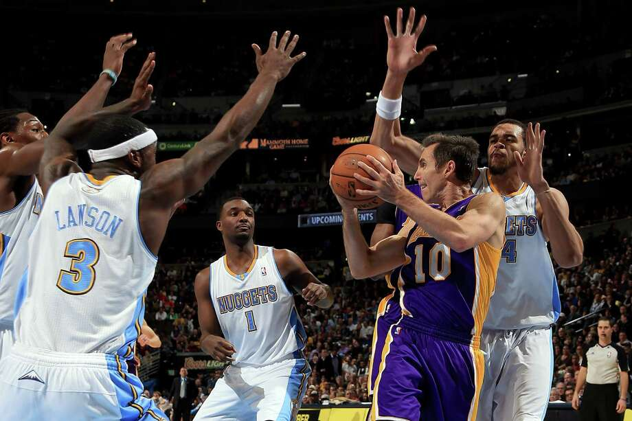 The Lakers' Steve Nash (10) is surrounded by the Nuggets' Kenneth Faried (35),  Ty Lawson (3), Jordan Hamilton (1) and JaVale McGee (34) as he looks to pass during Monday night's game at Denver. Photo: Doug Pensinger, Staff / 2013 Getty Images
