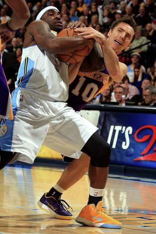 Ty Lawson (left) and Denver wrestled the season series from Steve Nash and the Lakers after Monday's 119-108 victory. Lawson scored 22 points. Photo: Doug Pensinger / Getty Images