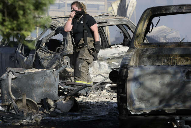 A firefighter goes through the wreckage at one of the homes that burned in the Pearsall Road fire. In San Antonio, wind gusts ranged from 30 to 50 mph.