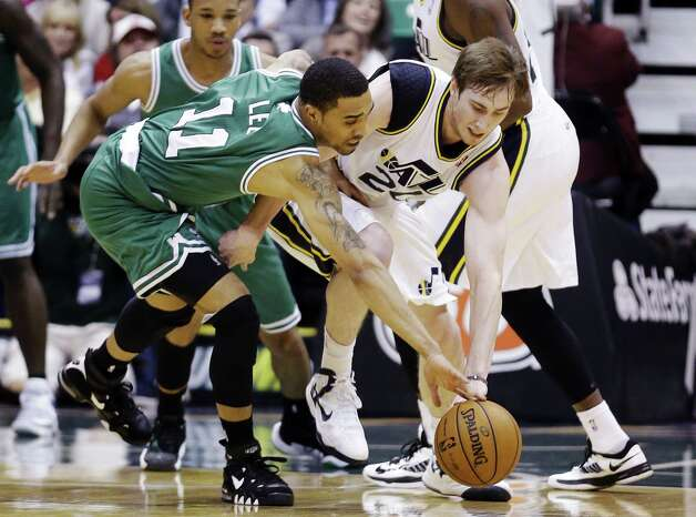 Utah Jazz's Gordon Hayward, right, and Boston Celtics' Courtney Lee (11) chase a loose ball in the second quarter during an NBA basketball game, Monday, Feb. 25, 2013, in Salt Lake City. (AP Photo/Rick Bowmer) Photo: Rick Bowmer
