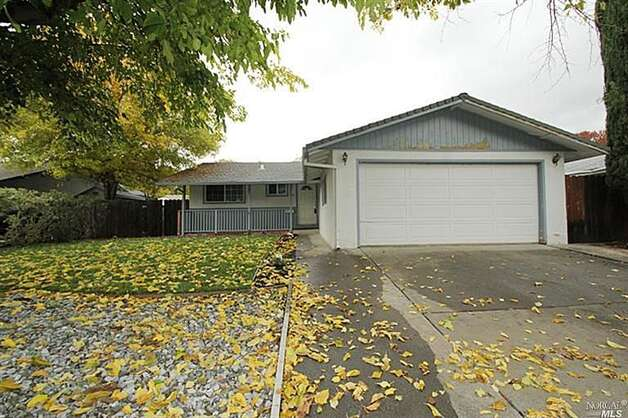 This 3-bedroom, 2-bathroom single-family home is listed for $215,000 at 449 Beelard Drive in Vacaville. It was sold in a foreclosure auction last fall for $177,100, but back in 2004 it sold for $370,000.