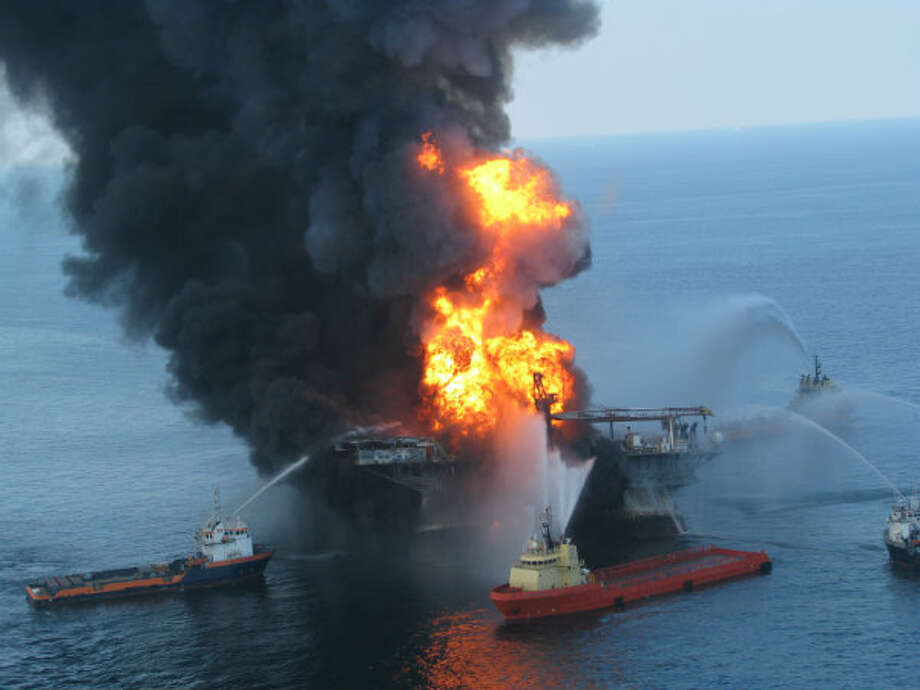 Fire boat response crews battle the blazing remnants of the off shore oil rig Deepwater Horizon on April 21, 2010. The blowout in the Gulf of Mexico killed 11 people and sent 4.9 million barrels of oil gushing from the sea floor into the Gulf.