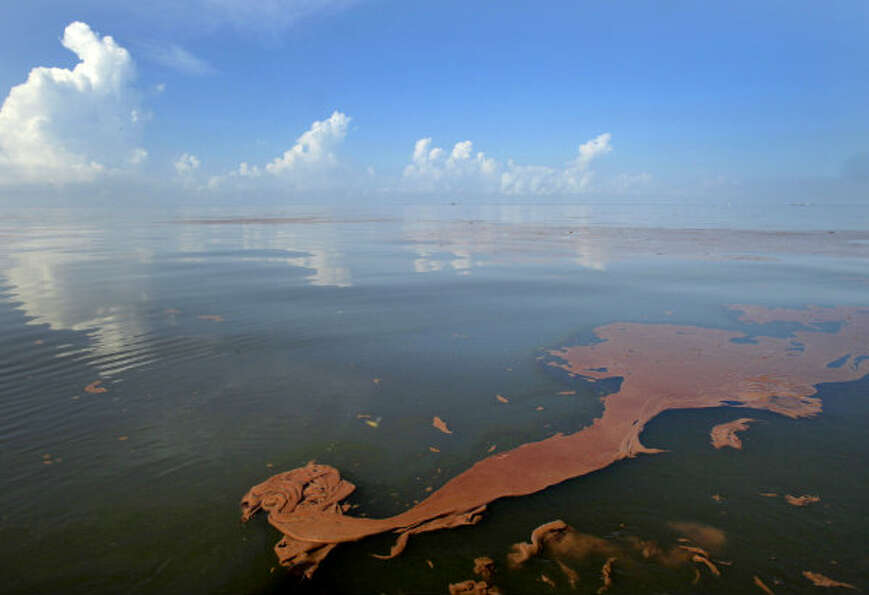 Oil from the Deepwater Horizon spill floats on the water as the sky is reflected in sheen on Baratar