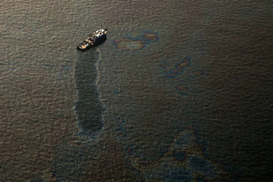 A boat is surrounded by oil near the site of the Deepwater Horizon explosion and oil spill on Tuesday, June 15, 2010.