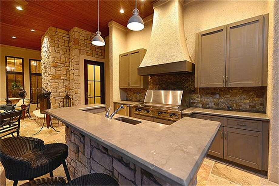 Closer view of outdoor kitchen with gas grill, fridge and sink. Photo: Better Homes And Gardens Real Estate Gary Greene