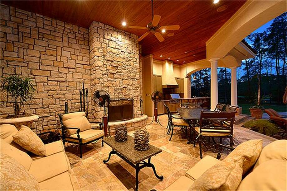Outdoor living at its finest. Wood burning fireplace adds ambiance. Photo: Better Homes And Gardens Real Estate Gary Greene