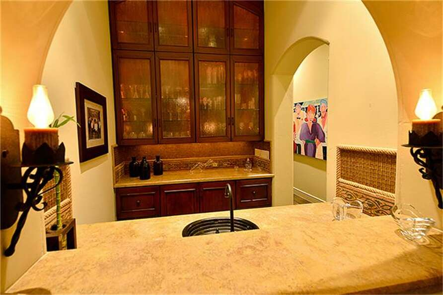 Between dining room and kitchen, separate wet bar with fridge adds entertainment appeal.