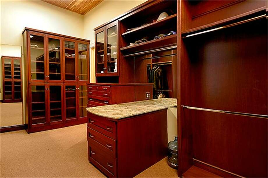 Both master closets are large, with upscale built-ins. Photo: Better Homes And Gardens Real Estate Gary Greene