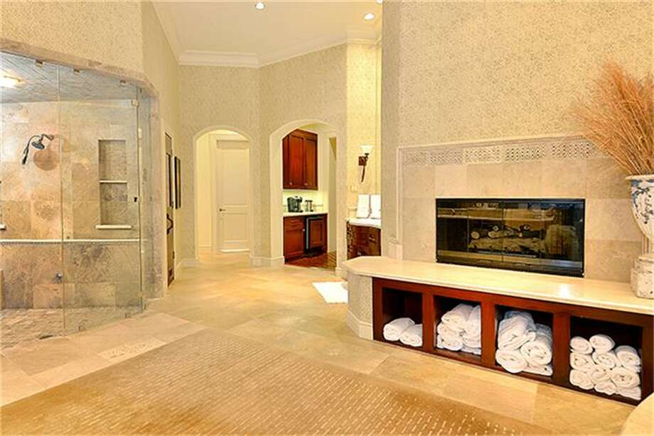 Add to the Spa list - there's a sauna and enormous shower with steam feature. Photo: Better Homes And Gardens Real Estate Gary Greene
