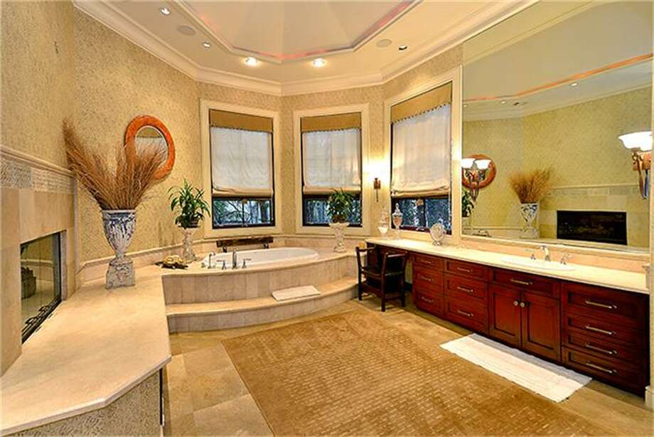 Coffee station, fireplace, double vanities, marble floors and whirlpool tub. Photo: Better Homes And Gardens Real Estate Gary Greene